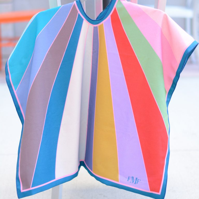 Color Cape with blue, cream, gold, pink and red