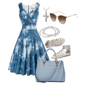 White background, blue tie-dye dress. Medium blue purse, silver cross necklace, sunglasses, bangle bracelets and gladiator sandals