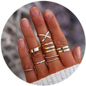 Women's hand with midi rings