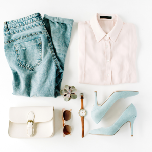 White backgound with light jeans, white shirt, blue highheels, sunglasses and necklace