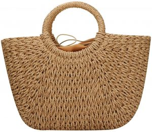 White background with straw handbag or purse